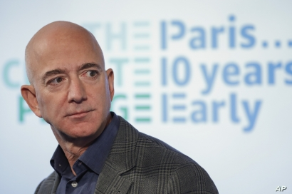 Amazon CEO Jeff Bezos speaks during his news conference at the National Press Club in Washington, Thursday, Sept. 19, 2019. Bezos announced the Climate Pledge, setting a goal to meet the Paris Agreement 10 years early. (AP Photo/Pablo Martinez…