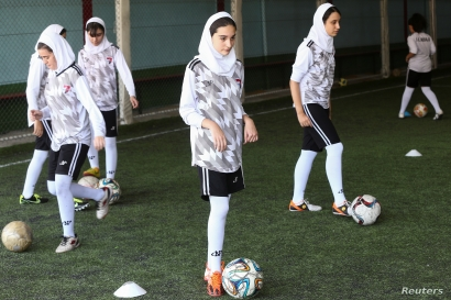 Iranian women exercise at a football school in Tehran, Iran, Sept. 14, 2019.