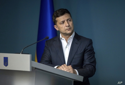 FILE - Ukrainian President Volodymyr Zelenskiy speaks during a meeting with law enforcement officers in Kyiv, Ukraine, July 23, 2019.