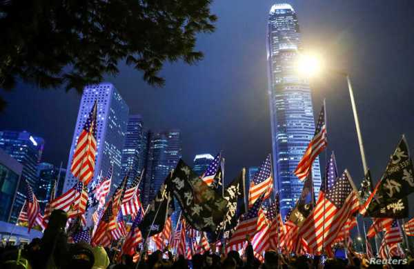 FILE - Protesters hold U.S. flags during a rally at Edinburgh Place, in Hong Kong, Nov. 28, 2019.