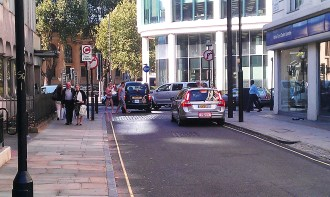 Cleveland Street and traffic at Euston Road intersection