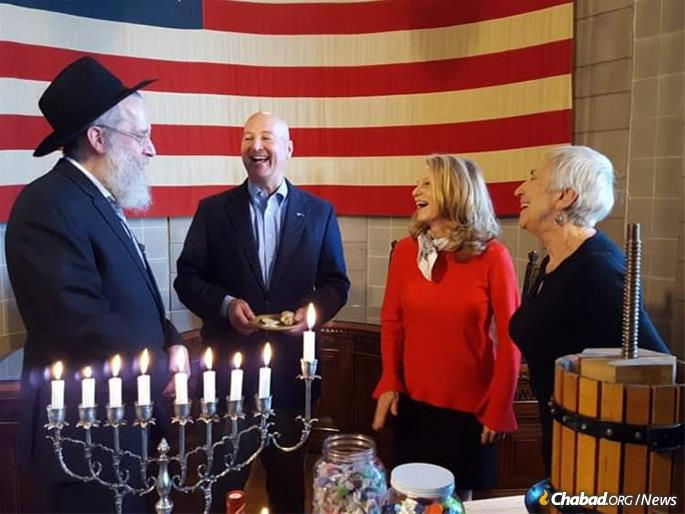 While scheduled conflicts prevented capitol metro light this year, Gov. Pete Ricketts has tackled menorah previously Chabad lighting at the Capitol State in Lincoln, including last year (pictured). Gov. Ricketts post-Chanukah message delivered in January.