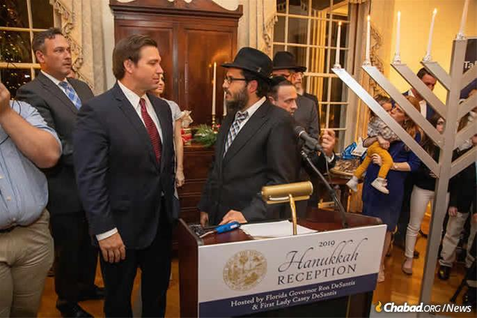 Holding Gov. Ron DeSantis and the First Lady Casey DeSantis Chanukah reception at the Governor's mansion in Tallahassee. (Credit: Tallahassee Bus)