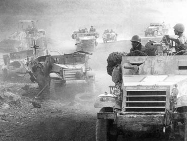 IDF forces ascend the Golan Heights as abandoned Syrian tanks lay near the road.Photo: Israel National Photo Archive