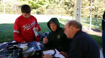 John, KG4NXT, explaining HF SSB operating with a couple of Scouts