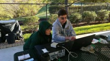 Kevin, KX4KU, explaining to a Scout digital HF communications