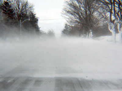 Photo of snow drifint on road
