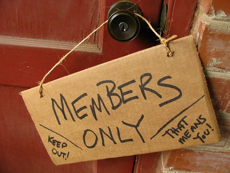 Members only sign handing on door knob