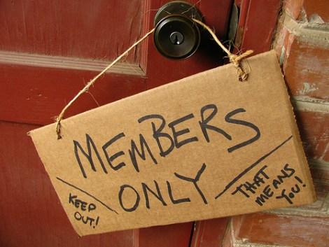 Members only sign handing on door knob
