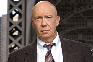 Dann Florek as SVU's Captain Donald Cragen