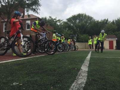 Going over basic skills on Bike Camp Day 1