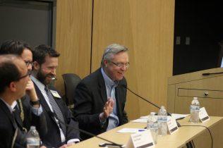 "Tom Sherwood moderating the Closing Plenary, ""Towards Regional Collaboration and Commitments."""