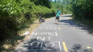 Matthew finishes up navigational chalk marking for the Anacostia River Trail