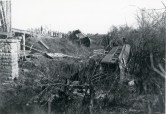 Two passenger train cars are visible here, derailed at an unidentified location near Alma, Kansas.