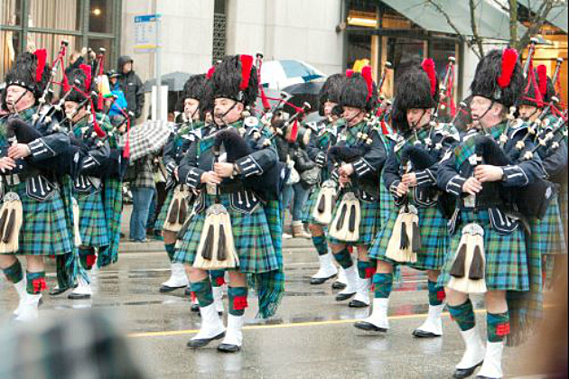bagpipers marching in a parade