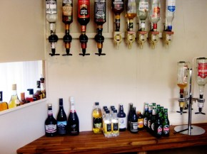 Painted and smaller bench and shelves put in behind the bar.