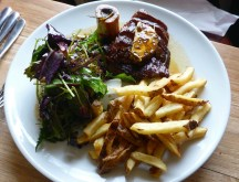 Bavette steak with roasted bone marrow, hand cut chips & salad