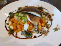 Sea bass fillets with leeks, vegetables and sauce vierge