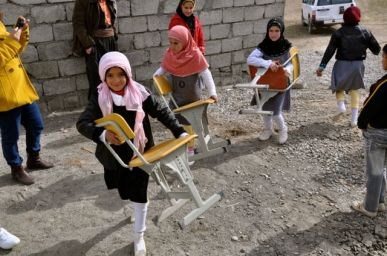 students-move-furniture-in-on-the-day-the-trailers-arrived-toutakhel-iraq-february-13-2012