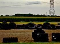 Tires and corn. Copyright Robert Hartwig.