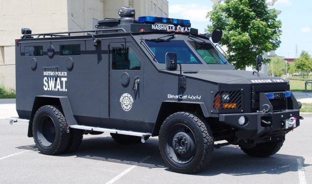 The Lenco BearCat is an armored vehicle that was transferred from the military to police departments through the 1033 program. (Wikipedia)
