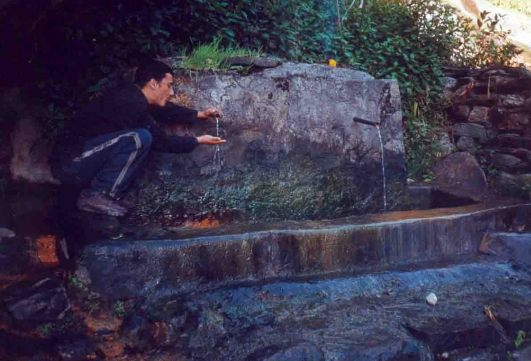 touching hot spring water
