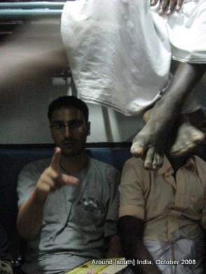 dangling legs of passengers in a train to madhurai from kanyakumari