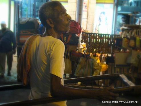 runner-pulled rickshaws of kolkata, india