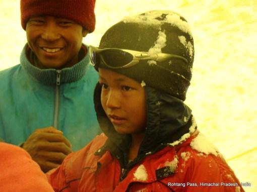 a boy and snow rohtang pass himachal pradesh india