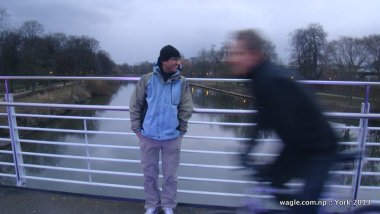 A cyclist passed by as Dinesh Wagle posed for camera at the Millennium Bridge over River Ouse in York. Pic by Bishnu Pariyar