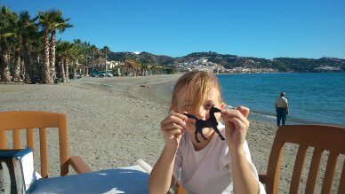 With La Herradura as background and a horsie she found on the beach