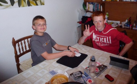 Adam teaching Lars card tricks