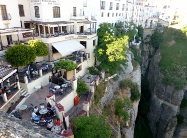 Ronda Spain perched up in the cliffs, an incredible place to visit. Read more on wagonersabroad.com