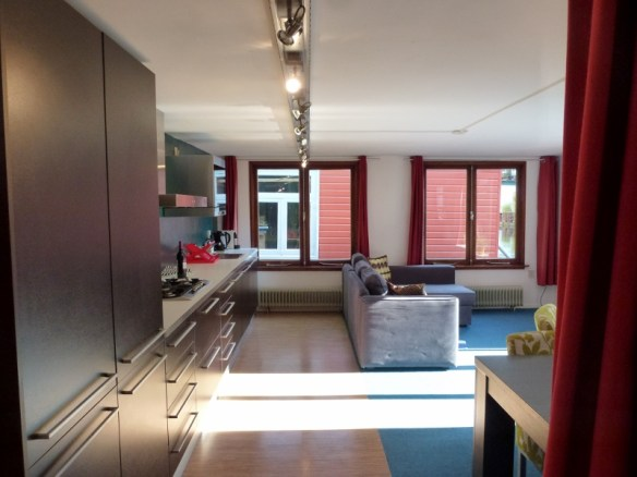 Amsterdam Houseboat #GowithOh Living room, kitchen and a peek at the dining table