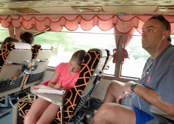 Koh Chang Journey - Anya doing homework on bus from Bangkok to Koh Chang