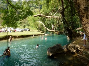 Vang Vieng Blue Lagoon Anya ready to jump from tree