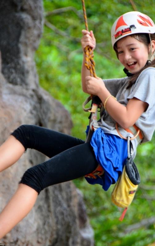 Felicia rock climbing