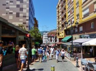 """""""Calle Gascona"""" and the images of the waiters pouring the Sidra in Oviedo Asturias."""