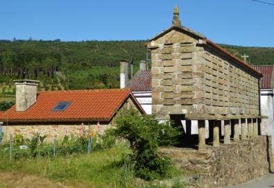 An hórreo is a typical granary from the northwest of the Iberian Peninsula (mainly Galicia, Asturias and Northern Portugal), built in wood or stone, raised from the ground by pillarsending in flat staddle stones to avoid the access of rodents. Ventilation is allowed by the slits in its walls.