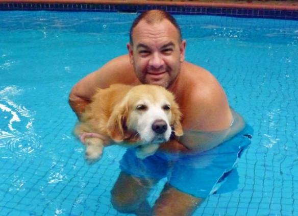 Alan-and-Luke swiiming at the pool in Kuala Lumpur during our housesit.