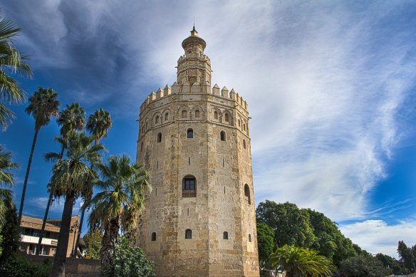 Take a photo at the Torre de Oro in Seville. Read more on WagonersAbroad.com