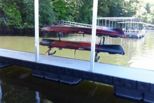double kayak rack on aluminum floating dock with floats and bumpers in picture