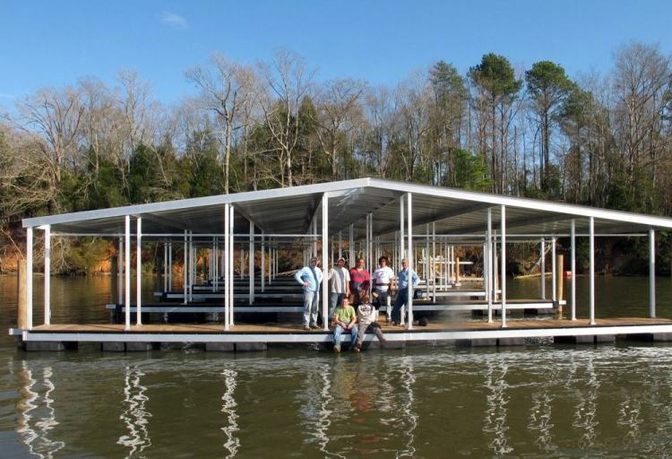 wahoo aluminum docks commercial dock - dock marina construction with gable roof and ipe dock decking - multiple dock floats
