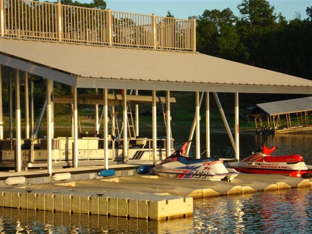 wahoo aluminum docks custom dock design - jet ski docking with upper deck and gable roof