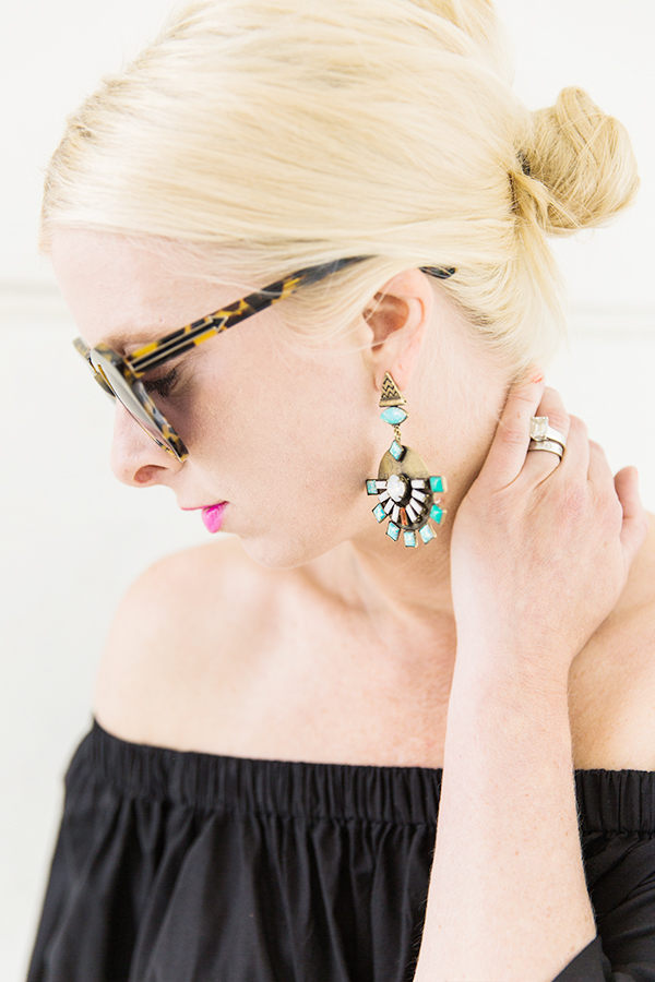 Low bun and statement earrings
