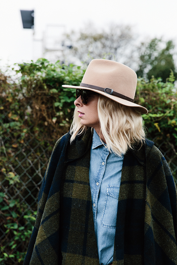 Cape, chambray shirt and wool hat