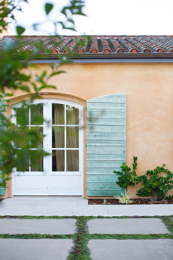 Stucco and green shutters