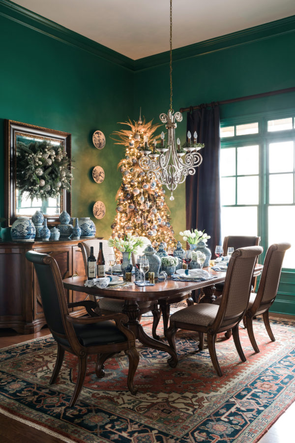 Emerald dining room with blue and white ginger jars
