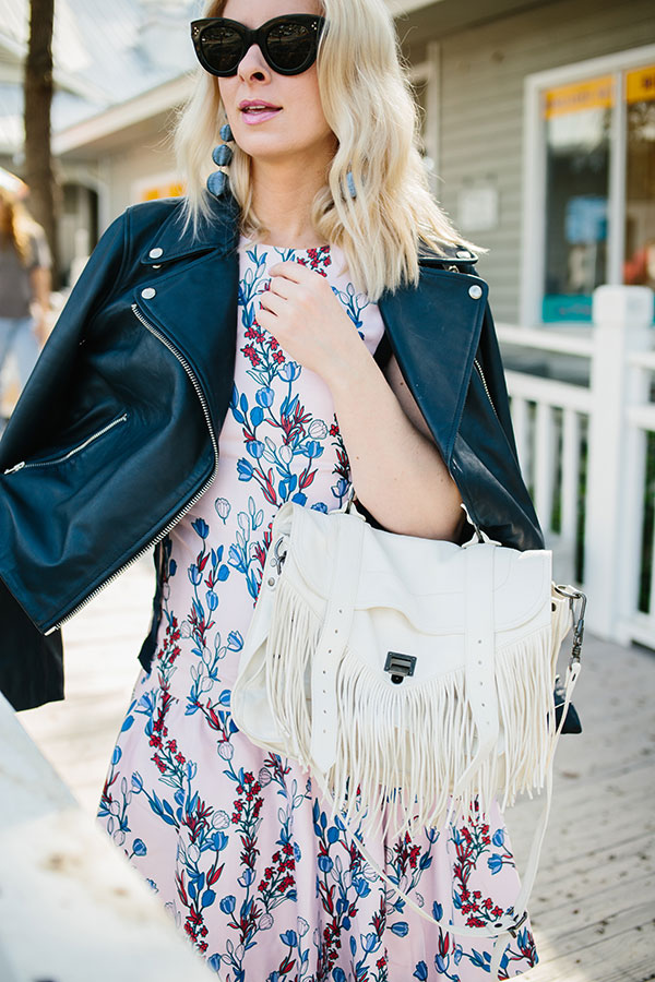 Light pink dress with leather jacket and white fringe bag outfit ideas via @waitingonmartha