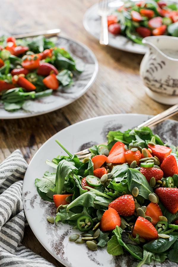 Strawberry kale salad with jalapenos, pumpkin seeds & Poppy Seed Dressing